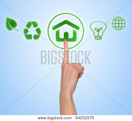Woman hand push environmental green house button
