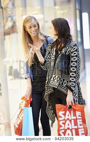 Two Female Friends With Bags In Shopping Mall