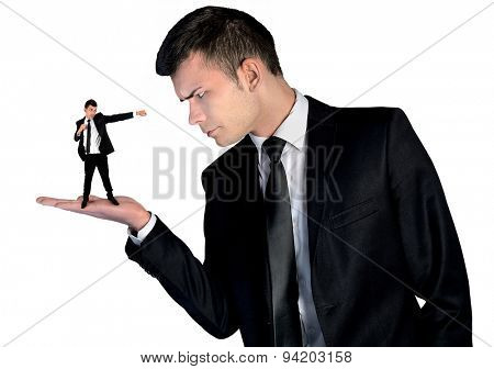 Isolated business man looking angry on little man