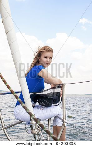 Sea Travelling Concepts: Sensual Caucasian Woman Sailing On Yacht Outdoors