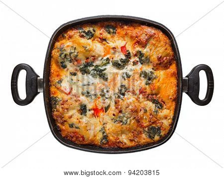 pot lasagna isolated on white background, view from above