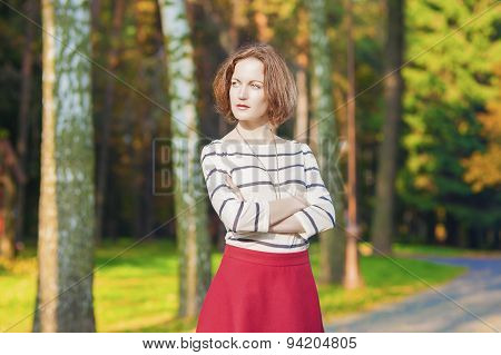 Fashion Concepts: Positive And Smiling Caucasian Brunette Female Posing In Fall Forest Outdoors.