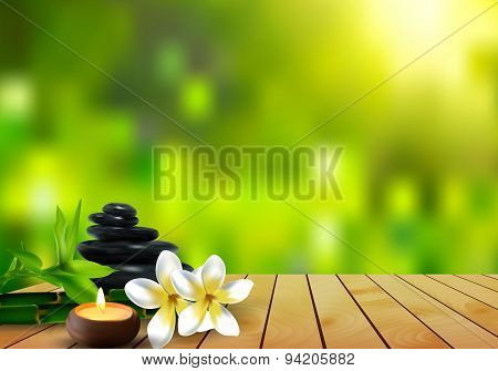 stone, flower, wax and bamboo background on the wood