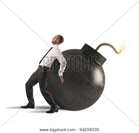 Businessman pushing a bomb