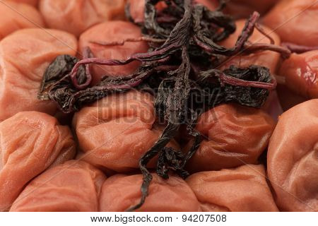Umeboshi with akajiso (red shiso /perilla ). Traditional Japanese food. Pickled plums