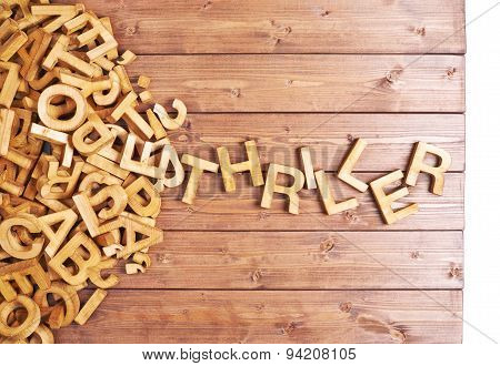 Word thriller made with wooden letters