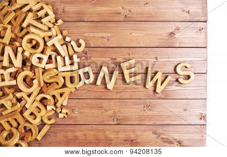 Word news made with wooden letters