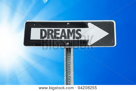 Dreams direction sign with a beautiful day