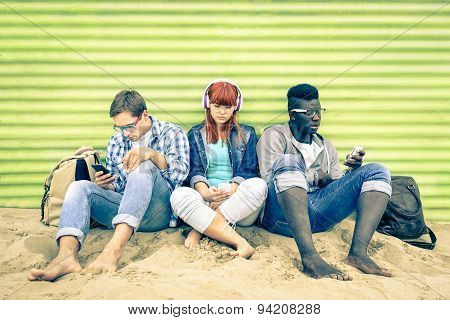 Group Of Young Multiracial Friends With Smartphone And Mutual Disinterest Towards Each Other