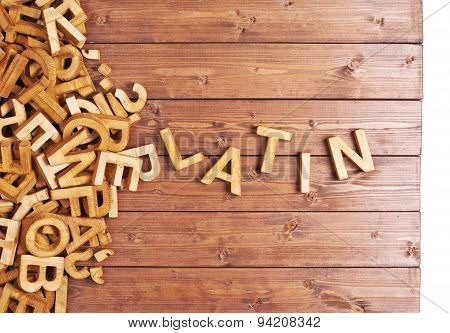 Word latin made with wooden letters