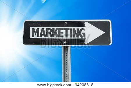 Marketing direction sign with a beautiful day