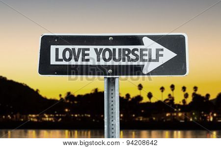 Love Yourself direction sign with sunset background