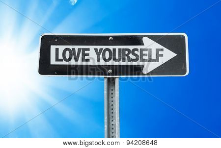 Love Yourself direction sign with a beautiful day