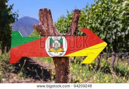 Rio Grande do Sul wooden sign with vineyard background