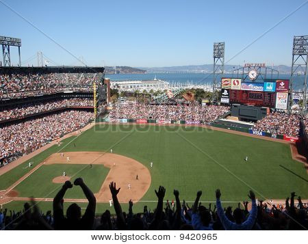 Fans With Arms In Air After Homerrun By Buster Posey As He Trots Toward Third As He Rounds Bases