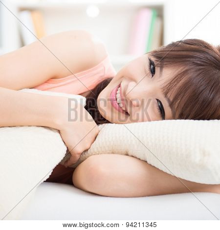 Portrait of attractive Asian girl awake in the morning. Young woman indoors living lifestyle at home.