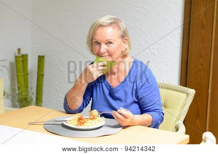 Senior Woman Eating A Meal