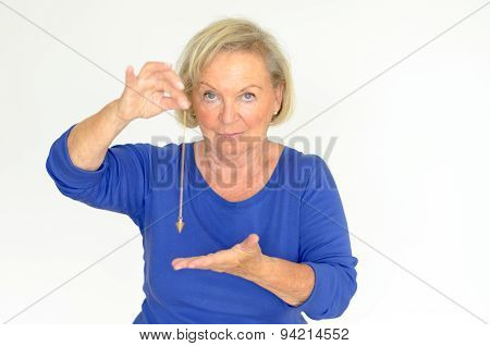 Woman Holding A Pendulum Over Her Hand