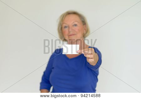 Elderly Lady Holding Out A Blank Card