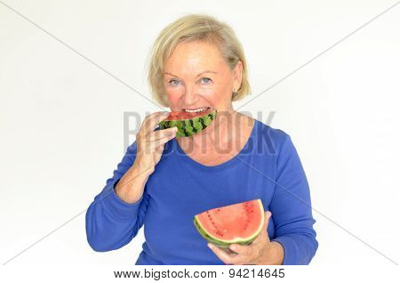 Elderly Lady Enjoying Fresh Watermelon