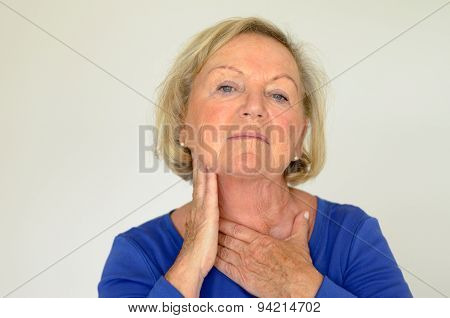 Thoughtful Elderly Woman With Her Hand To Her Neck