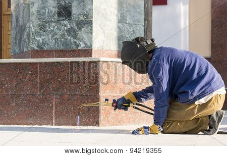 Construction Worker Welding Metal Rods
