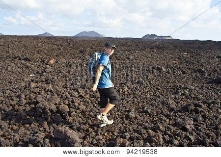 Boy On Walking Trail In Volcanic Area In Lanzarote