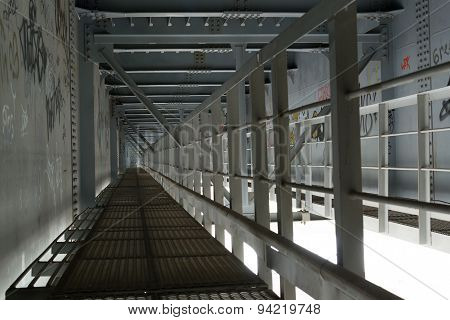 Metal Walkway Under A Bridge