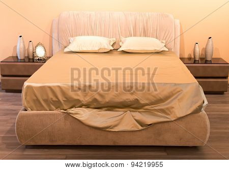 Cream Colored Bed And Silk Sheets