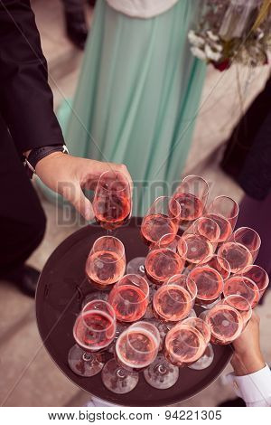 Guests Serving Drink At Wedding
