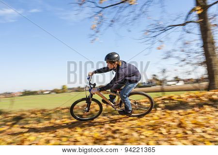 Boy Jumps Rides His Bicycle With Speed In Open Area And Enjoys Racing