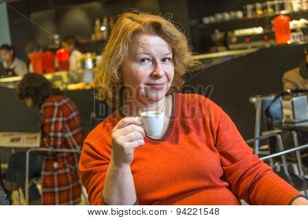 Nice Lady Enjoys A Cup Of Coffee