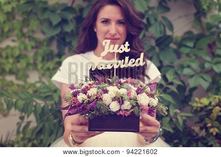 Happy Bride Hoding A Just Married Sign