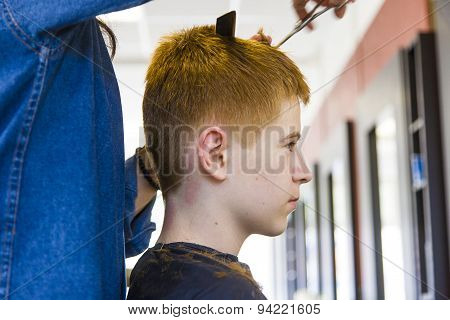 Boy At The Hairdresser, She Is Cutting - Close-up With Selective Focus On The Nose