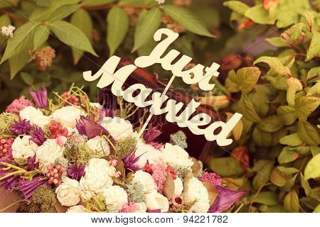 Just Married Sign In A Flower Bouquet