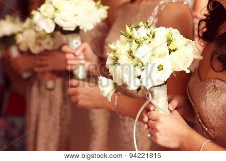 Bridesmaid Holding Lishianthus Bouquet