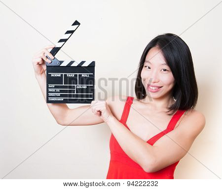Funny Asian Woman Red Dress With Movie Clapperboard On White