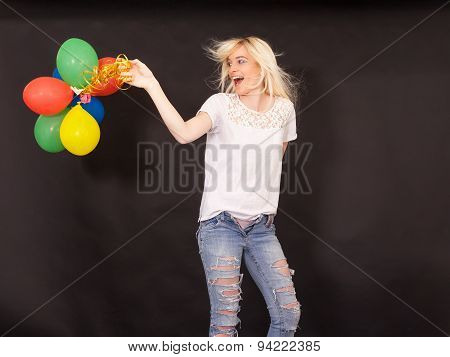 Young laughing woman with coloured aerial balloons