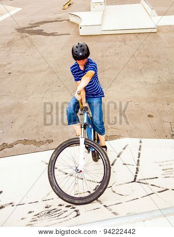 Boy Riding His Bike At The Skatepark