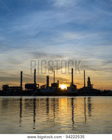 Oil Refinery Or Petrochemical Industry Plant At Sunrise
