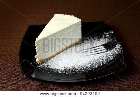 Cheesecake On A Dark Background