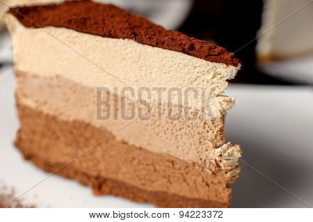 Chocolate Cheesecake On A Dark Background