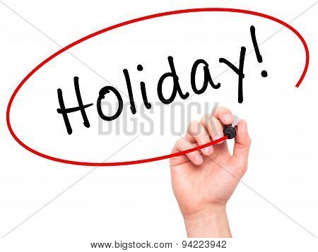 Man Hand writing Holiday! with black marker on visual screen.