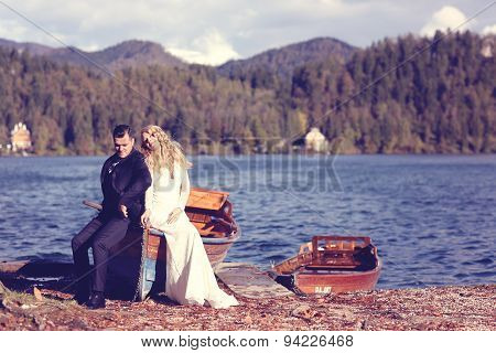 Bride And Groom In A Boat On Sunny Day