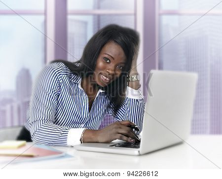 Attractive Black African American Ethnicity Woman Working At Computer Laptop At Business District Of