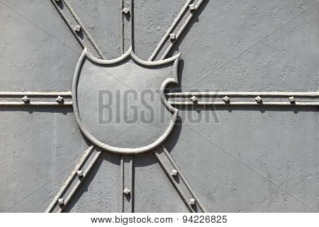 Empty blazon on a metal door