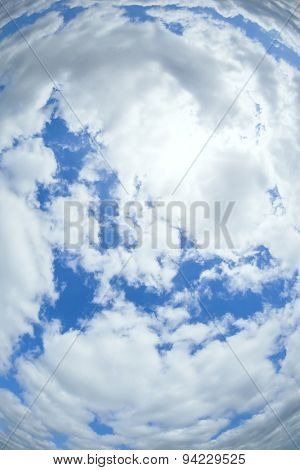 An image of a radial cloudy sky background