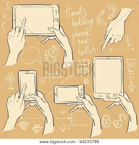 Hands holding smartphone and tablet.