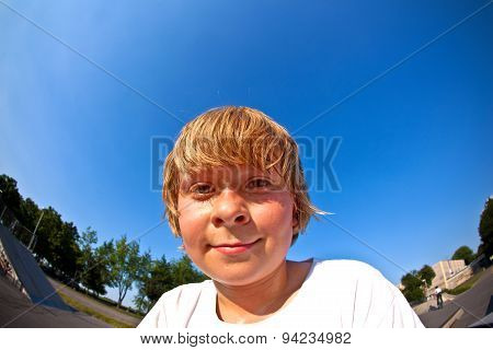 Young Boy At The Skate Park