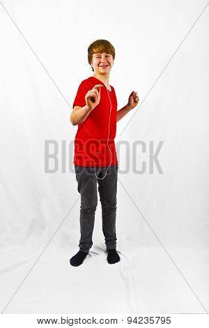 Happy Boy Listening To Music Via Earphone